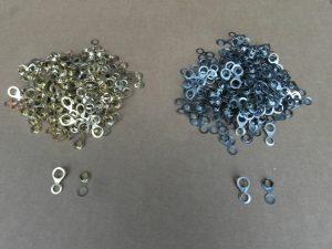Particolare in ferro e ottone ricavati da coils. Anellino per settore arredamento.